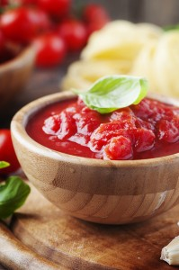 Italian traditional sauce with basil and tomato, selective focus