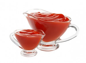 Ketchup in glass bowl isolated on white background. Portion of tomato sauce. With clipping path.